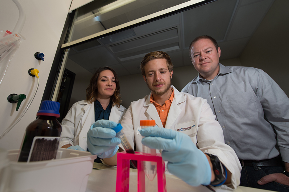 Primary Researcher Kenneth Oestreich, Ph.D. (right), Research Specialist and Laboratory Coordinator Kaitlin Read (left) and TBMH Graduate Student Michael Powell